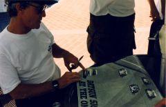 John checks out the BRE pace car before lending his autograph