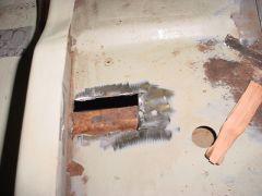 Rust spot on floor Passenger side