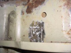 Repaired rust spot on Passenger side floor