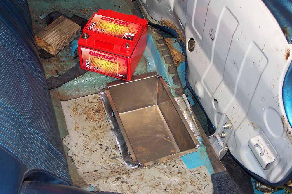 Battery box under back seat