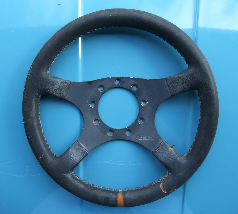 Old, well worn Formuling wheel...