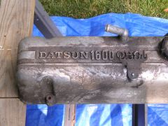 """Close up of early L series valve cover with """"DATSUN 1600 OHC"""" Ins"""