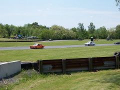 Dave Patten's Orange Race car on the Track