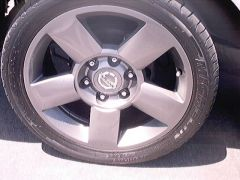 "'99 Frontier with  18"" Titan wheels"