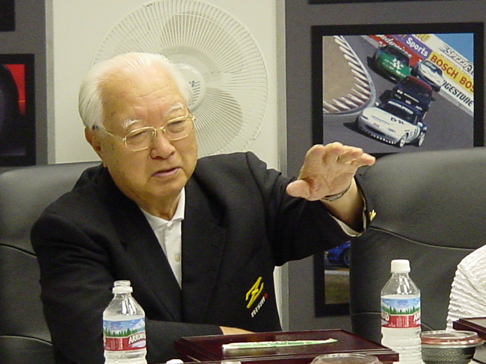 Mr. K addresses the audience at Mazdaspeed